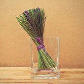 Bouquet of dried lavender flowers in a glass vase on wooden tabl — Stock Photo