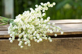 May-lily on wooden table — Stock Photo