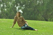 Young pretty woman lying on the grass — Stock Photo