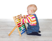 Cute baby girl playing with an abacus — Stock Photo