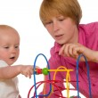 Stock Photo: Mother and baby playing together