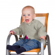 Distressed tearful baby in highchair — Stock Photo