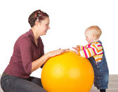 Mother and baby with a gym ball — Stock Photo