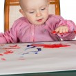 Adorable baby finger painting — Stock Photo
