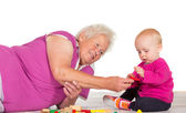 Gran babysitting her small grandchild — Stock Photo
