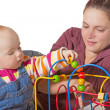 Stock Photo: Young baby learning muscle coordination