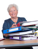Positive senior woman in the office — Stock Photo