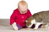 Baby girl with the family cat — Stock Photo