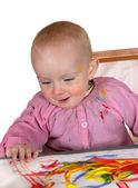 Happy baby girl finger painting — Stock Photo