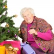 Royalty-Free Stock Photo: Happy grandmother preparing for Christmas