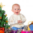 Royalty-Free Stock Photo: Laughing baby surrounded by Christmas gifts