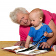 Stock Photo: Grandmother and baby reading book