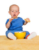 Little baby eating biscuits — Stock Photo