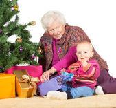 Grandmother babysitting young baby — Stock Photo