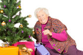 Happy grandmother preparing for Christmas — Stock Photo