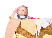 Impish little baby in the laundry — Stock Photo