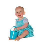 Adorable baby playing with a bucket — Stock Photo