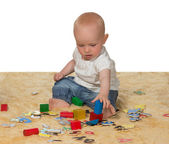 Young baby playing with educational toys — Stock Photo
