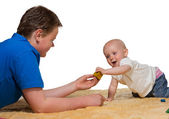 Happy inquisitive baby playing with Dad — Stock Photo