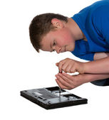 Man fixing a laptop computer — Stock Photo