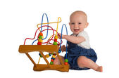 Happy baby with educational toy — Stock Photo