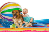 Adorable baby with dog — Stock Photo