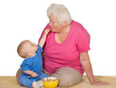 Tender moment between baby and grandmother — Stock Photo