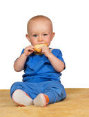 Adorable baby eating a bun — Stock Photo