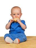Adorable baby eating a bun — Stock Photo
