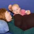 Little baby girl with her pregnant mother — Stock Photo