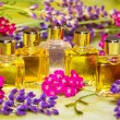 Stock Photo: Fresh spring flowers with essential oil