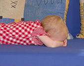 Little baby girl lying face down — Stock Photo