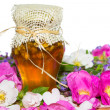 Honey jar with blossoms and herbs — Foto Stock