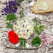 Stock Photo: Delicious herb butter with bread
