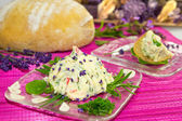 Delicious herb butter and bread. — Stock Photo