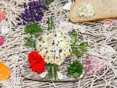 Delicious herb butter with bread — Stock Photo