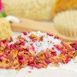 Bath salts and rose petals — Stock Photo