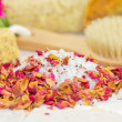 Stock Photo: Bath salts and rose petals