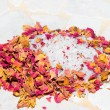 Fragrant dried rose petals with bath salts — Stock Photo
