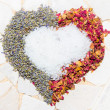 Stock Photo: Heart of rose petals, lavender and bath crystals