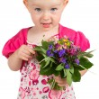 Pretty little girl with a bunch of garden flowers — Stock Photo