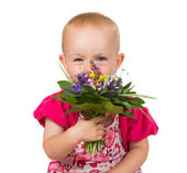 Beautiful little girl with a posy of flowers — Stock Photo
