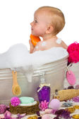 Cute little girl in a bubble bath — Stock Photo