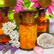 Naturopathy with gemstones and flowers — Stock Photo
