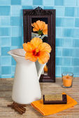 Bathroom still life with hibiscus flower in a jug — Stock Photo