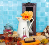 Spa still life with hibiscus flower in a jug — Stock Photo