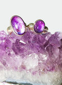 Amethyst crystals and jewellery — Stock Photo