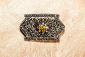 Marcasite brooch with central gemstone — Stock Photo