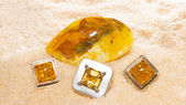 Amber cabochons set in jewllery — Stock Photo