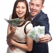 Woman and man with the money — Stock Photo